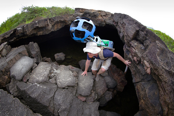 Daniel Orellana of the Charles Darwin Foundation climbsout of a lava tunnel where he was collecting imagery. Thedramatic lava landscapes found on Isabela island tell thestory of the formation of the G